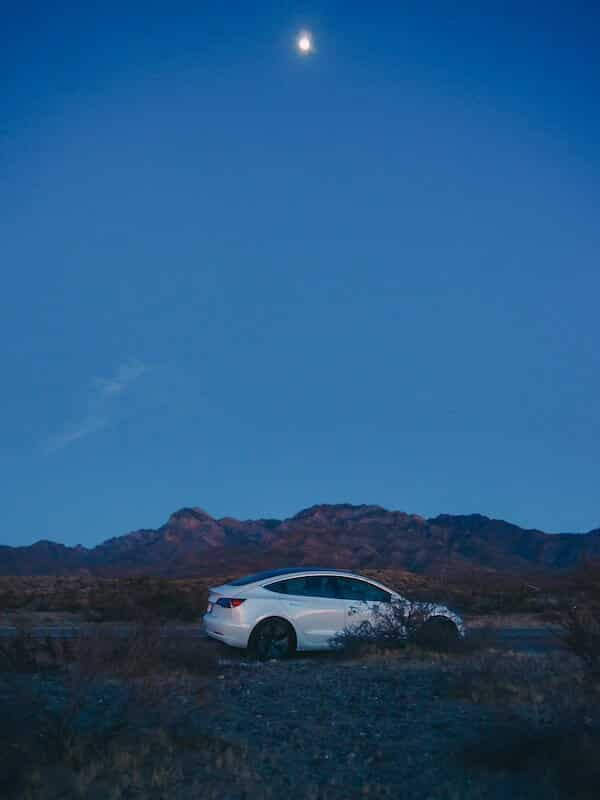 Tesla at night with moon