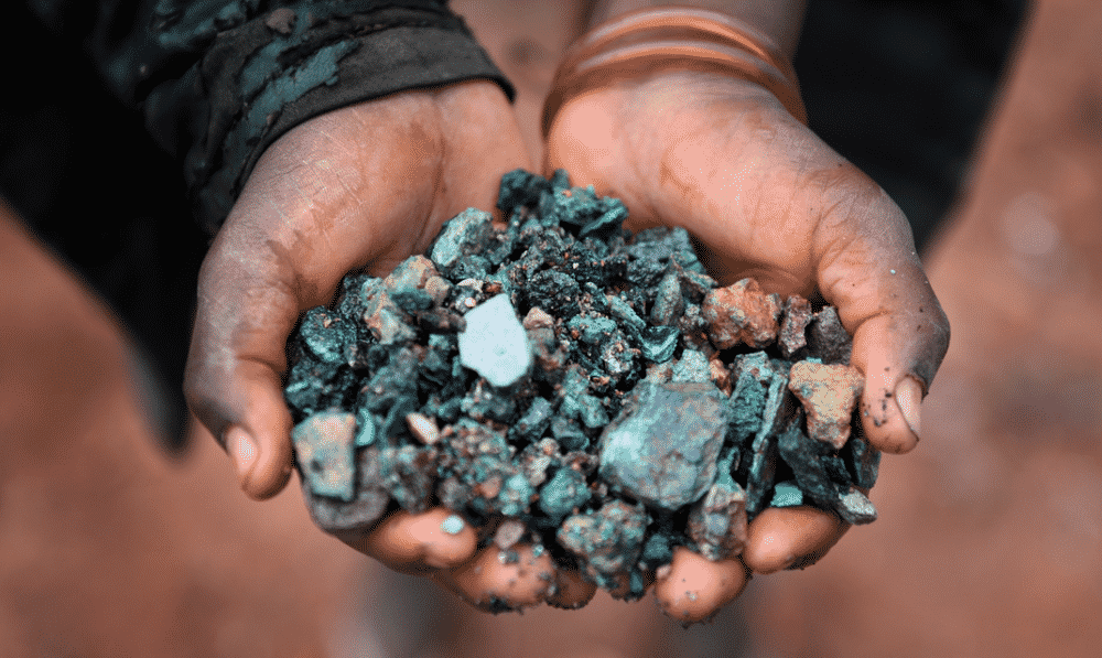 Hands filled with cobalt mineral